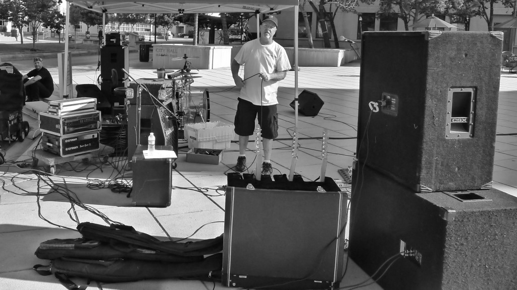 """Look carefully and you'll see Paul """"helping"""" Dave set up the PA for a gig… (I kid, I kid)"""